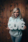 Happy blonde woman holding 2016 numbers Stock Image
