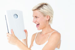 Happy blonde woman holding scales Stock Image