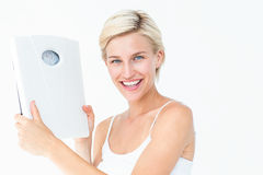 Happy blonde woman holding scales Stock Photos