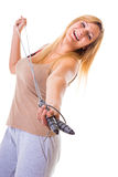 Happy blonde woman holding skipping rope Royalty Free Stock Photo