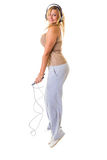 Happy blonde woman jumping on skipping rope Stock Image