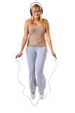 Happy blonde woman jumping on skipping rope Royalty Free Stock Photography