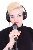 Happy blonde woman with microphone Royalty Free Stock Photos