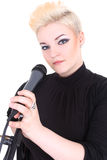 Happy blonde woman with microphone Stock Image