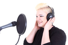 Happy blonde woman with microphone Stock Photos