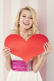 Happy blonde woman with paper heart Stock Image