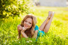 Happy blonde woman at park Royalty Free Stock Photo