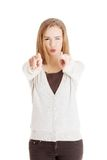 Happy blonde woman pointing on you Stock Photography