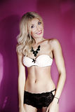 Happy blonde woman posing in lingerie. Royalty Free Stock Photo