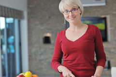 Happy blonde  woman prepare food in  the kitchen Stock Image