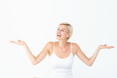 Happy blonde woman presenting something Stock Photo