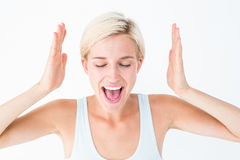 Happy blonde woman screaming with hands up Stock Photos