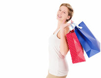 Happy blonde woman with shopping bags Royalty Free Stock Images
