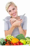 Happy blonde woman sitting above healthy food Stock Photo