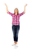 Happy blonde woman standing with hands up Royalty Free Stock Image