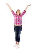 Happy blonde woman standing with hands up Royalty Free Stock Photos