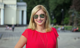 Happy blonde woman in sunglasses Royalty Free Stock Photography
