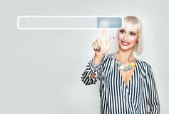 Happy Blonde Woman Surfing on Internet. Female Model with Empty Address Bar Virtual Display Royalty Free Stock Images
