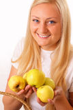 Happy blonde woman with tasty apples Royalty Free Stock Image