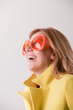 Happy blonde woman wearing weird sunglasses Stock Image