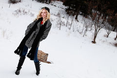 Happy Blonde Woman in Winter Clothes Royalty Free Stock Image