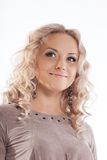Happy blonde young woman with curly hair Stock Photography