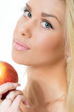 Happy blonde young woman holding apple isolated on white background Stock Photo