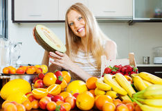Happy blonde young woman holding melon Royalty Free Stock Images
