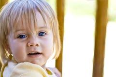 Happy blue eyed baby girl stock photo