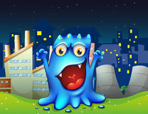 A happy blue monster in the city Royalty Free Stock Photo