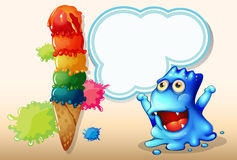 A happy blue monster beside the huge icecream Royalty Free Stock Photography