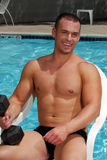 Happy bodybuilder by the pool Stock Photo