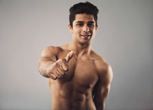 Happy bodybuilder showing thumbs up sign Royalty Free Stock Photography