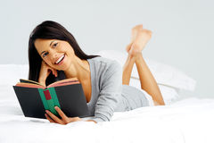 Happy book reading woman Stock Photo