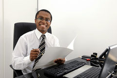 Happy bookkeeper reading documents. At desk stock images