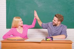 Happy bookworm. Couple of man and woman in classroom. Happy couple. Modern school. Knowledge day. Home schooling. Back stock photo