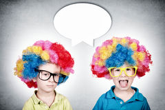 Happy and bored twin Royalty Free Stock Image
