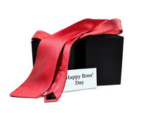 Happy Boss' Day. Red tie with a happy boss' day card for the man in your life, isolated on a white background royalty free stock images