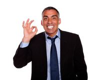 Happy boss saying great job. Portrait of a happy boss saying great job with the hand against white background Stock Photo