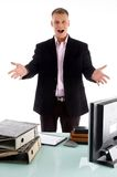 Happy boss showing his work table Royalty Free Stock Photos