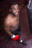 Happy Boxer Man Practices Working Heavy Bag Stock Photography