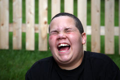 Happy boy. Laughing with open mouth stock photo