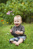 Happy boy. With sunglasses outdoors royalty free stock photos
