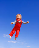 Happy Boy. Father throwing up his son. Blue sky on the background stock images