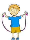 A happy boy. Jumping with a rope royalty free stock photography