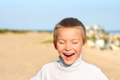 Happy boy. The happy child boy on the empty beach Royalty Free Stock Images