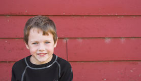 Happy Boy. And a red barn background Royalty Free Stock Photo