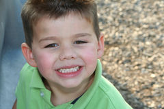 Happy Boy. Portrait of a smiling young boy outdoors stock photography