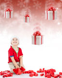 Happy boy. Boy playing with block toys and gifts falling down Stock Photography