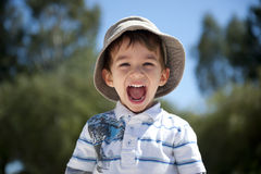 Happy Boy. Is enjoying a sunny day outside in the park stock photos